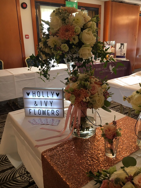 Top table designs, wedding flowers, martini table centrepiece