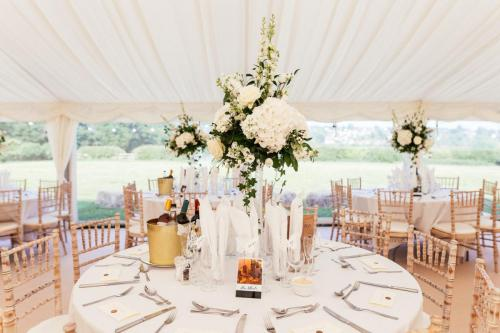 table flowers in marquee