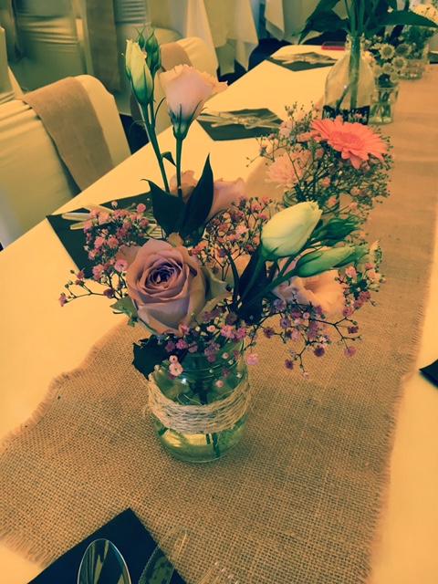 Jam jar filled with summer flowers