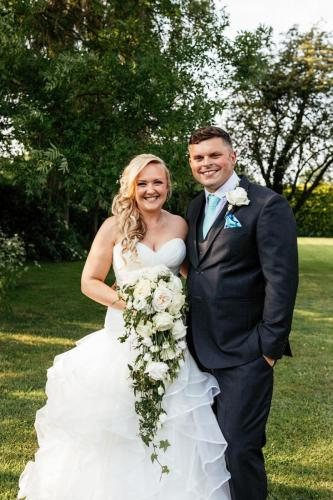 bride and groom with trailing bouquet, flowers