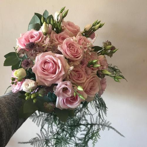 Pink Brides bouquet with trails to the front