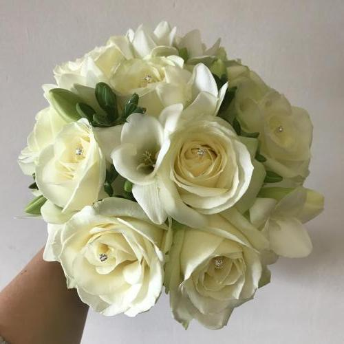 All white compact bouquet with sparkles